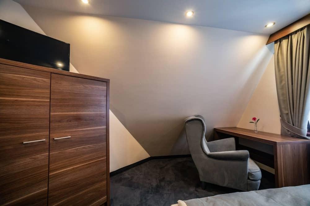 Familien-Suite, Mehrere Betten, Bergblick - Wohnbereich