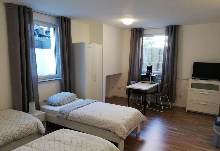 Beckers Ferienappartements, Eppelheim, Standard-Apartment (Souterrain, Nr. 1), Zimmer