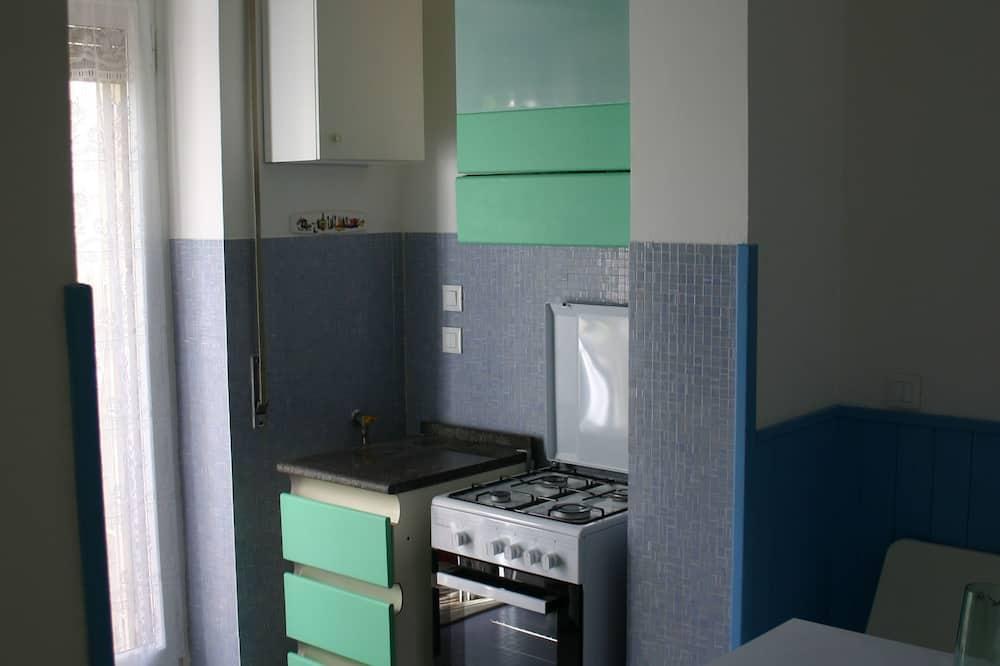 Familie driepersoonskamer, uitzicht op tuin - Gemeenschappelijke keuken