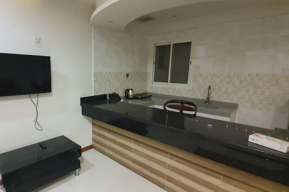 ビジネス アパートメント 1 ベッドルーム - リビング エリア