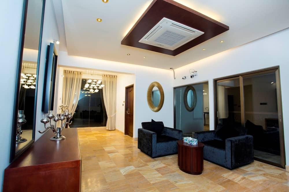 Deluxe szoba, 1 nagyméretű egyszemélyes ágy - Nappali rész