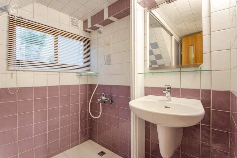Štvorposteľová izba typu Comfort - Kúpeľňa