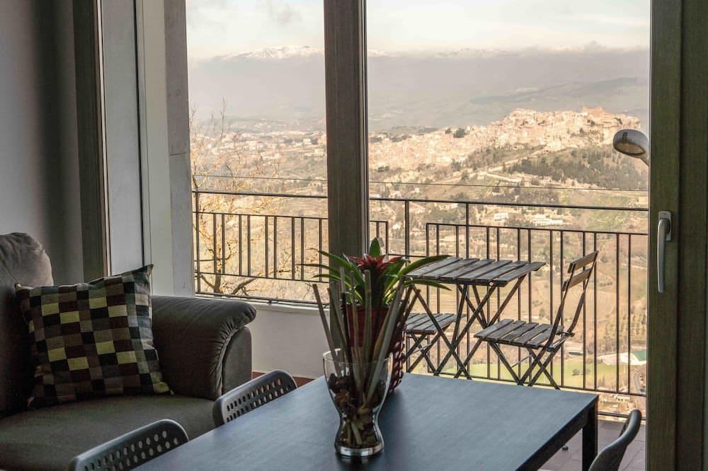 Deluxe-lejlighed - 1 queensize-seng - balkon - bjergudsigt (Euno) - Opholdsområde