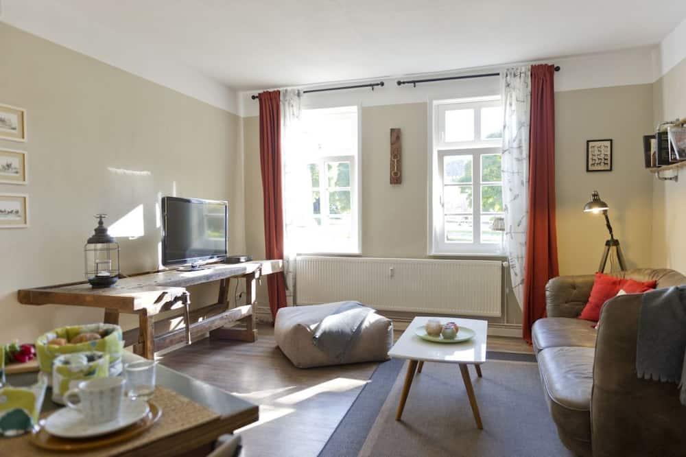 Romantisches Apartment, Gartenblick - Wohnbereich