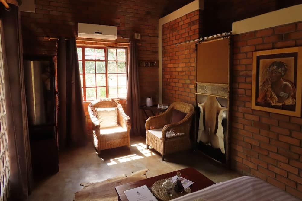 Habitación estándar, 1 cama Queen size, vista al jardín - Sala de estar