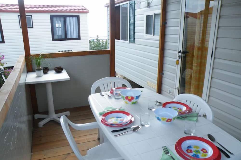 Mobile Home, Multiple Beds (CAPRAIA) - In-Room Dining