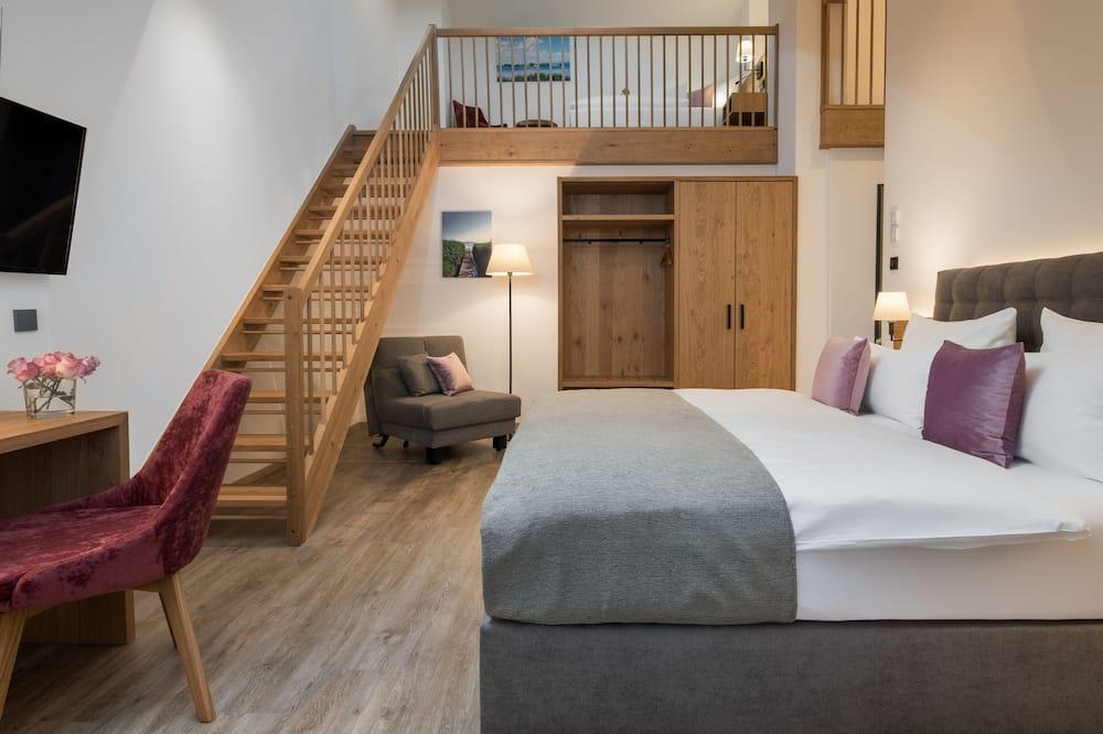 Junior Suite (mit Gallerie) - Living Room