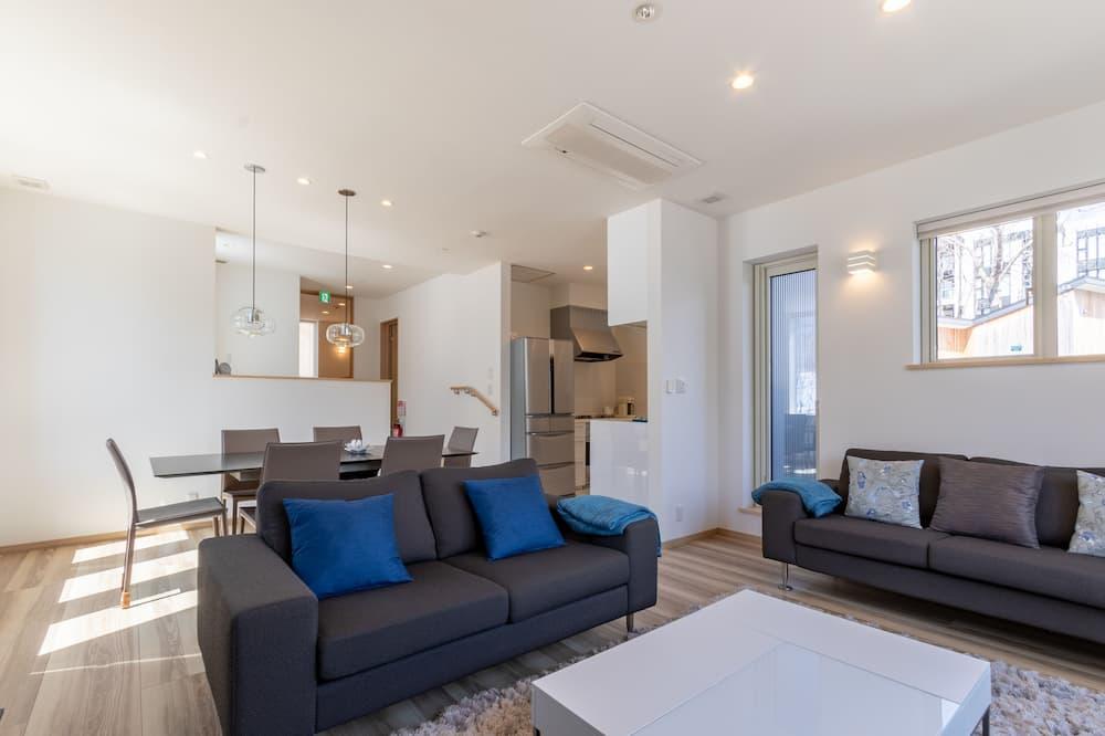Ferienhaus (Private Vacation) - Wohnzimmer