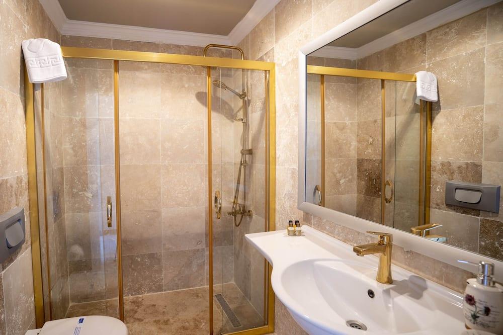 Pokoj typu Deluxe, částečný výhled na moře - Koupelna
