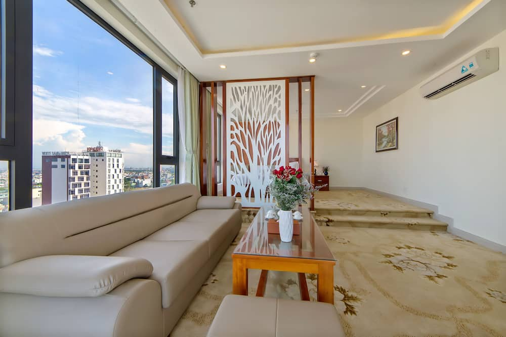 Chambre, balcon, vue mer (Suite) - Coin séjour