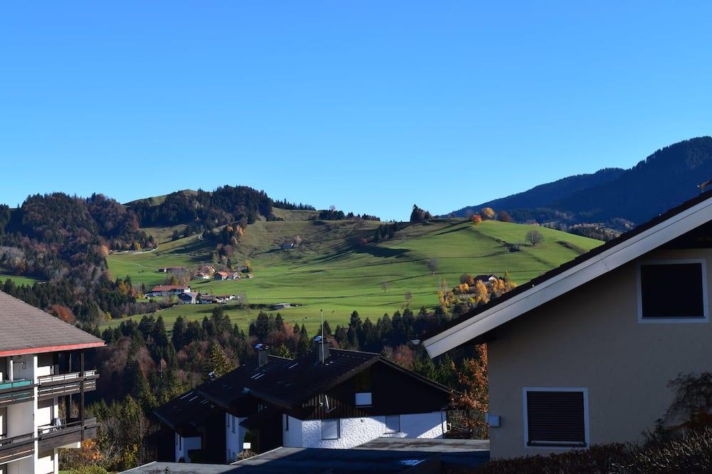 Lägenhet - utsikt mot bergen - Bild