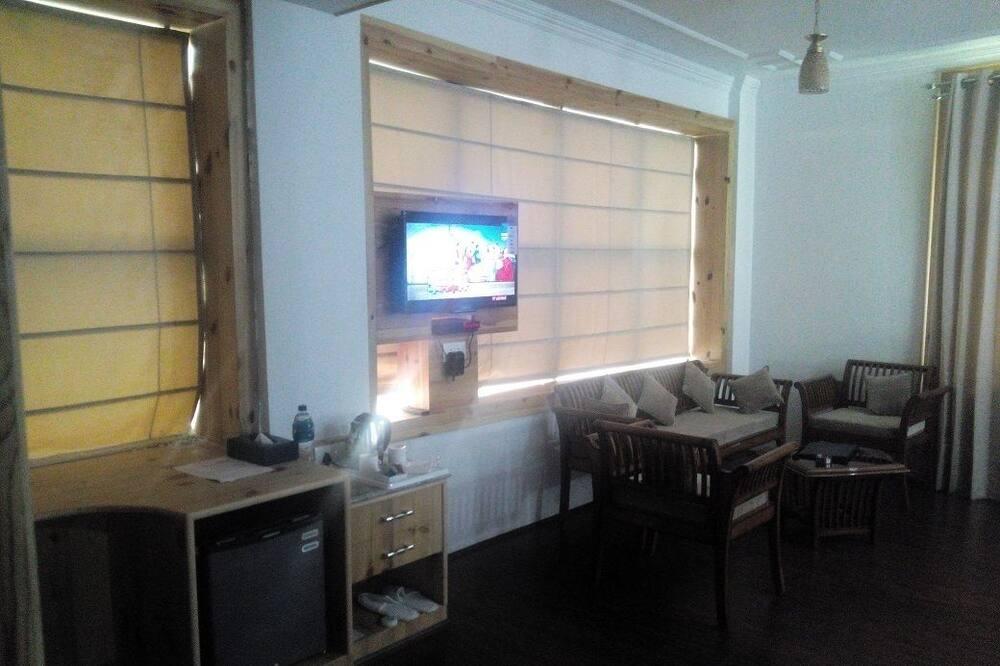 غرفة بريميم - منظر للحديقة - منطقة المعيشة