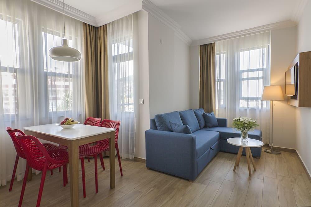Apartmán typu City, výhled na město - Obývací prostor