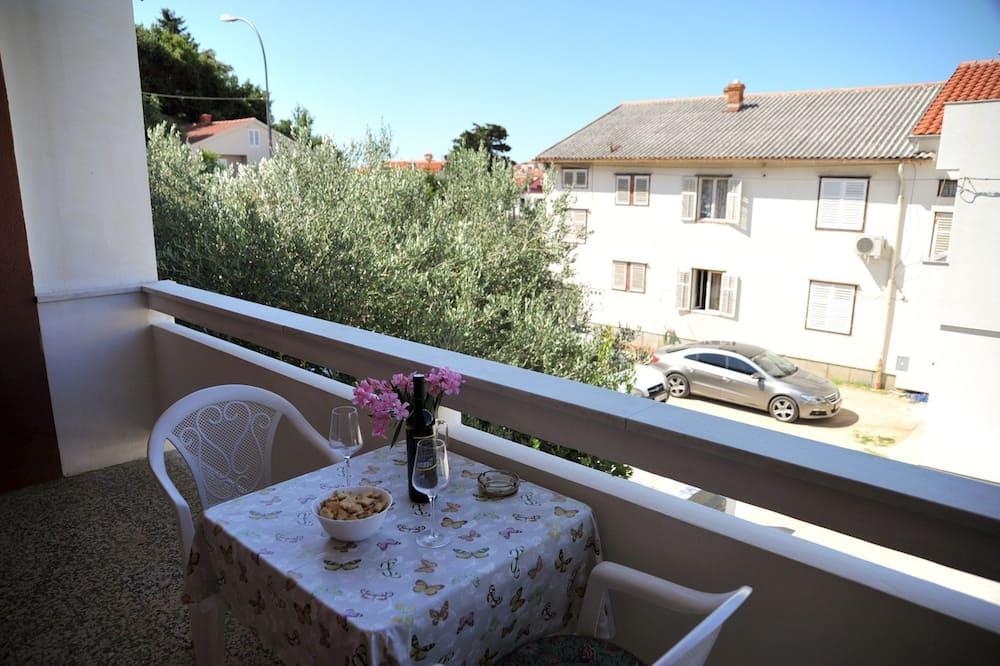 Zimmer, 1King-Bett und Schlafsofa - Balkon