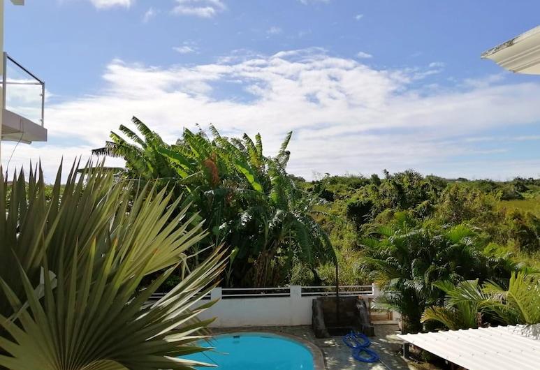 Apartment With one Bedroom in Pereybere, With Shared Pool, Enclosed Garden and Wifi - 500 m From the Beach, Grand-Baie, Kolam Renang