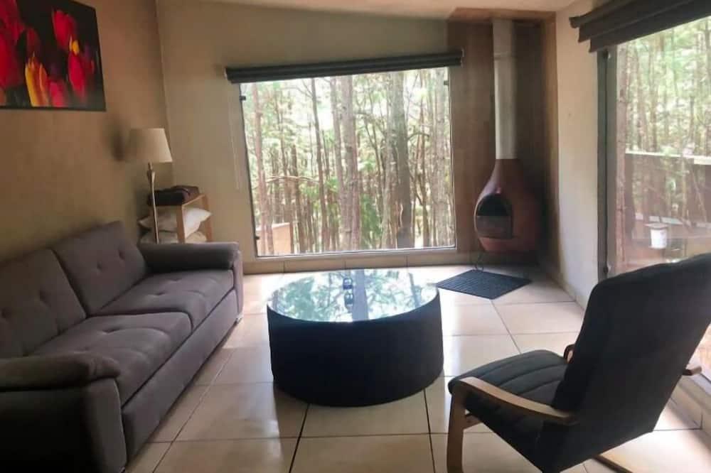 Habitación Deluxe, 1 cama King size con sofá cama, vista a la montaña - Sala de estar