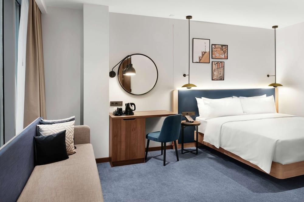 غرفة - سرير ملكي - تجهيزات لذوي الاحتياجات الخاصة - منطقة المعيشة