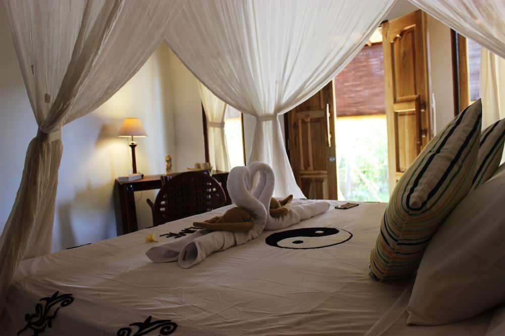 Kambarys (1 dvigulė / 2 viengulės lovos) su patogumais, vaizdas į sodą - Pagrindinė nuotrauka