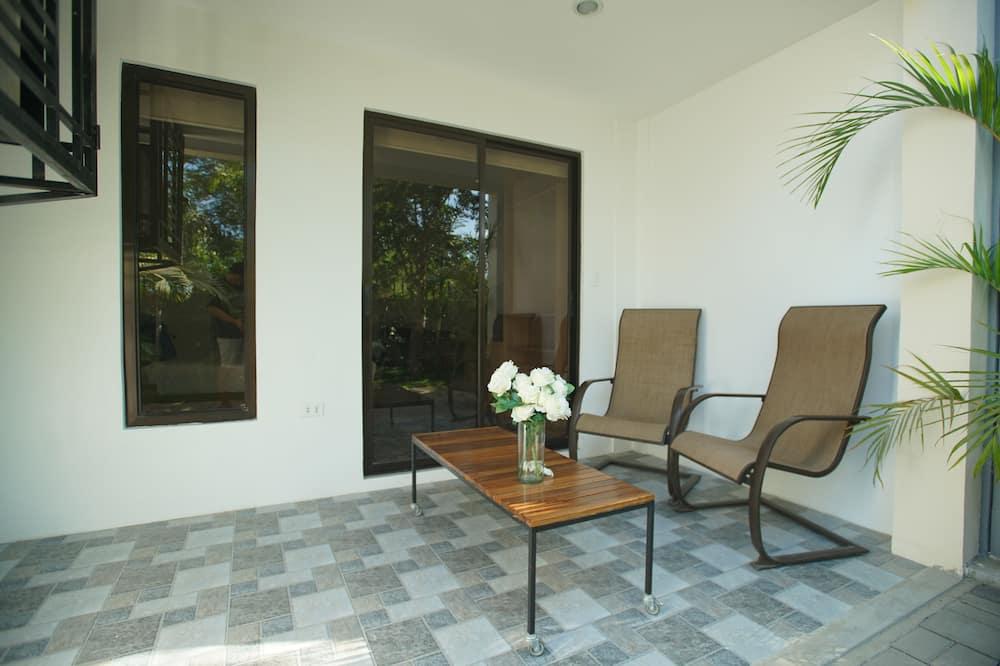 Deluxe Triple Room, Garden View - Balcony
