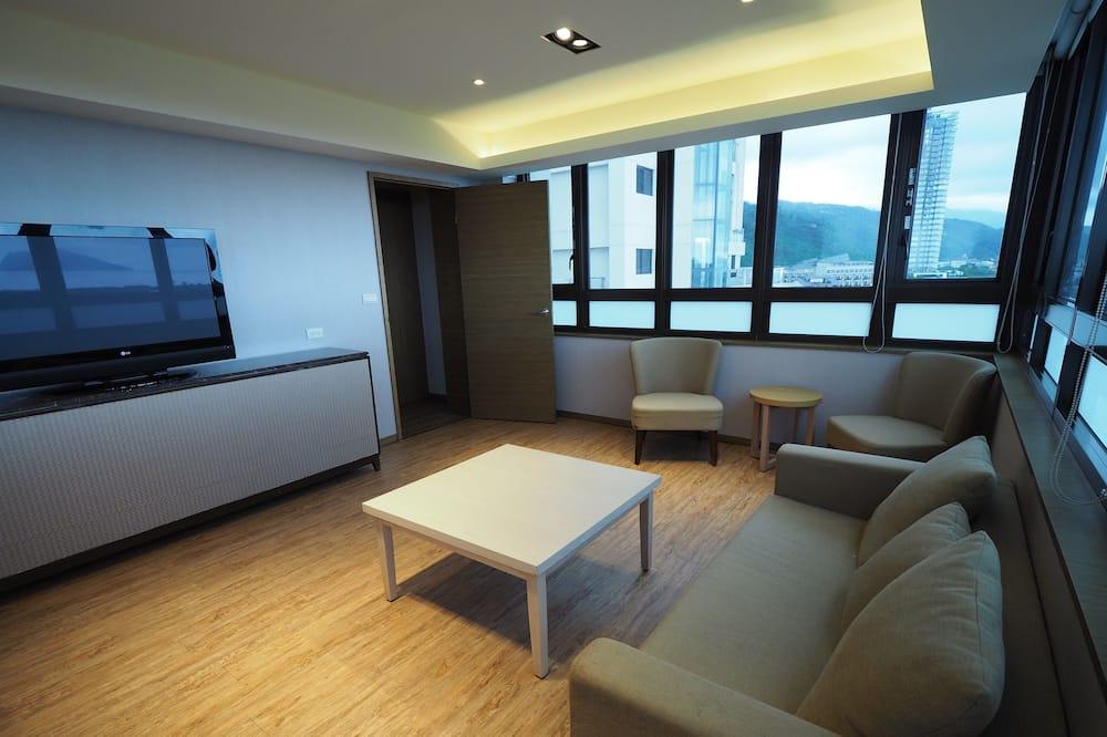 Deluxe Quadruple Room - Living Area