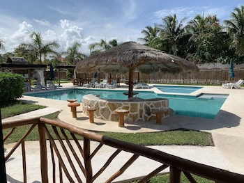 Picture of TAFFEIT Beach Hotel in Puerto Morelos