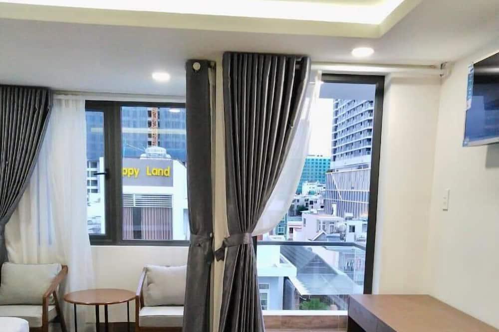 Deluxe driepersoonskamer, Balkon, Uitzicht op de stad - Uitzicht vanaf kamer