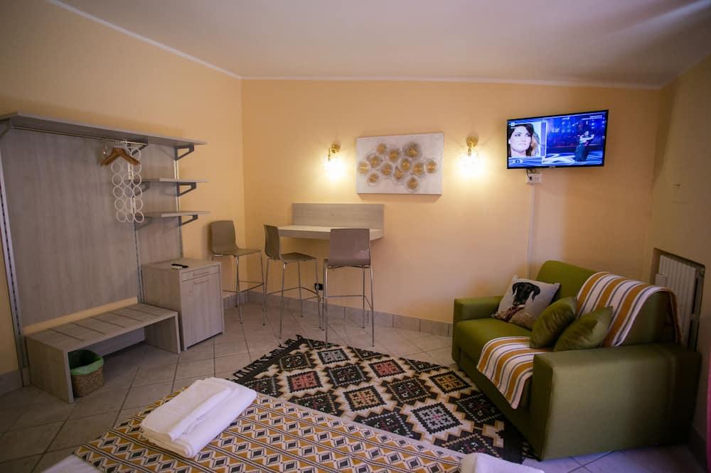 Улучшенный номер, 1 двуспальная кровать «Квин-сайз» с диваном-кроватью - Зона гостиной