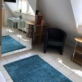 Classic Condo, Courtyard View - Living Area