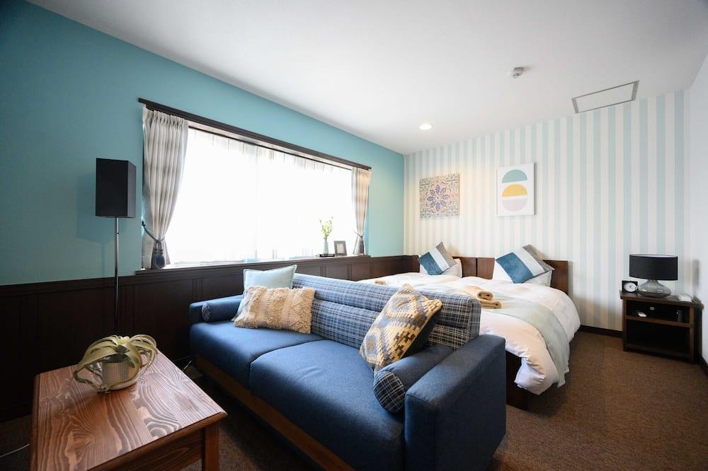Quarto Twin Deluxe (Sofa bed: Self service) - Sala de Estar