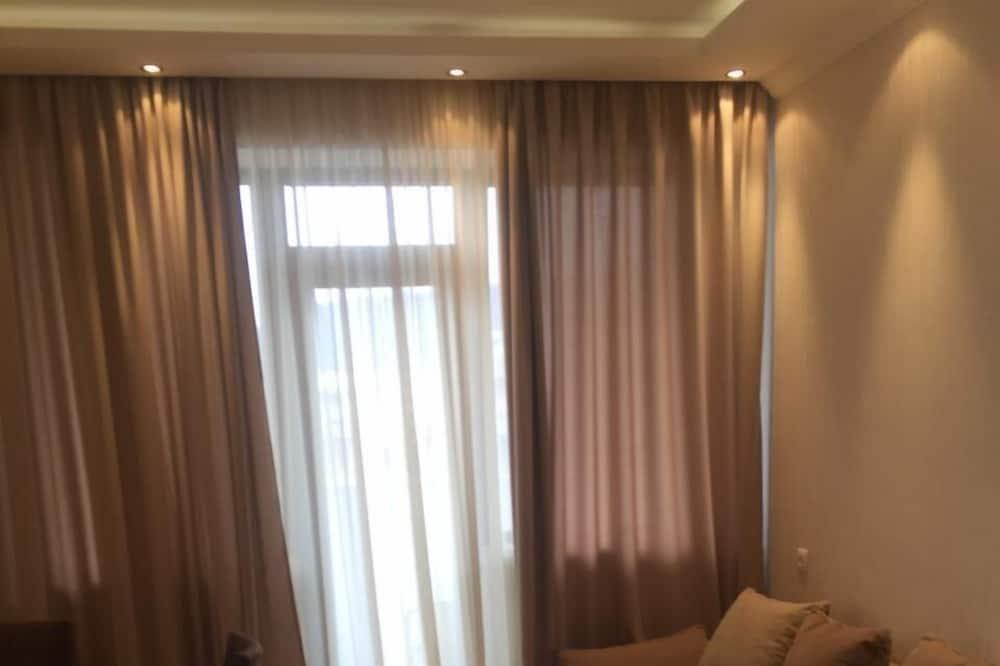 Стандартные апартаменты (1 Berbuki Street 12, Saburtalo) - Зона гостиной