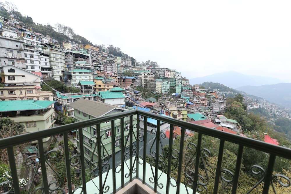 Luxe kamer - Uitzicht vanaf balkon