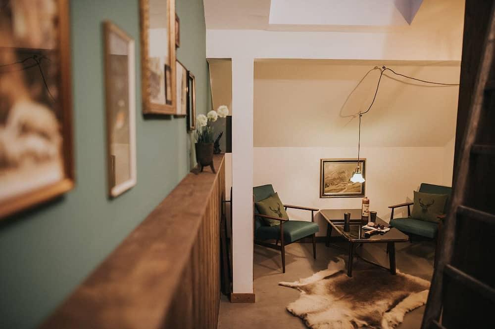 Třílůžkový rodinný pokoj (Fortshaus) - Obývací prostor
