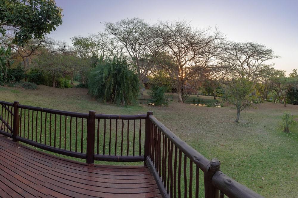 Casa estándar - Vista al jardín