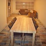 Familie appartement - Eetruimte in kamer