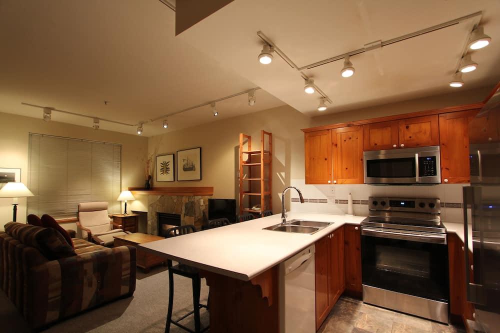 開放式套房, 1 張加大雙人床和 1 張沙發床, 地面層 - 客廳