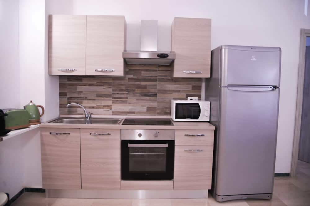 Standarta trīsvietīgs numurs (Verde) - Kopīga virtuve