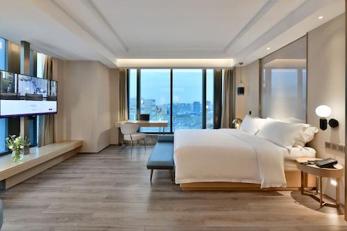 宜賓港美居酒店/