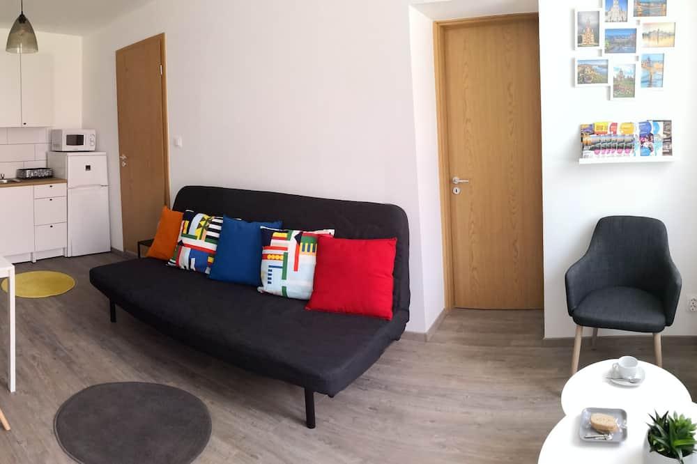 Apartemen, 1 kamar tidur, patio - Ruang Keluarga