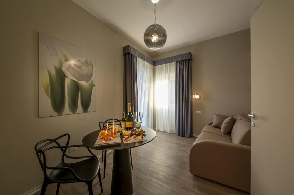 Deluxe Quadruple Room (Annamaria) - Living Area