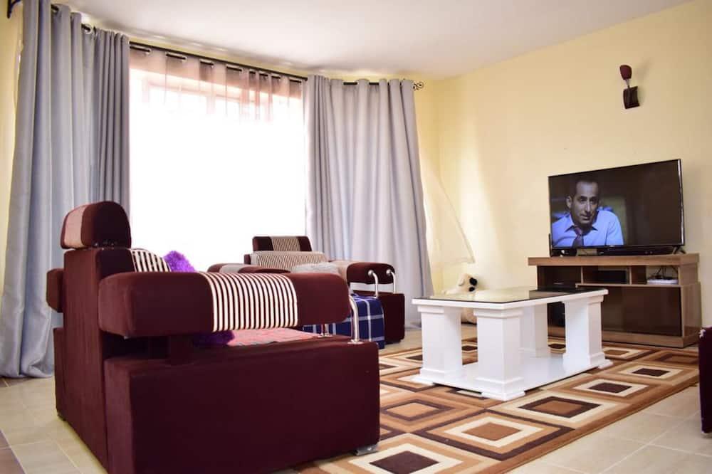 Chambre Deluxe - Salle de séjour