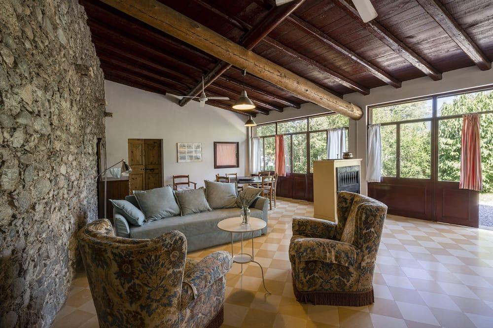 Apartamentai su patogumais, 2 miegamieji, 2 miegamieji, vaizdas į sodą (Giardino) - Svetainė
