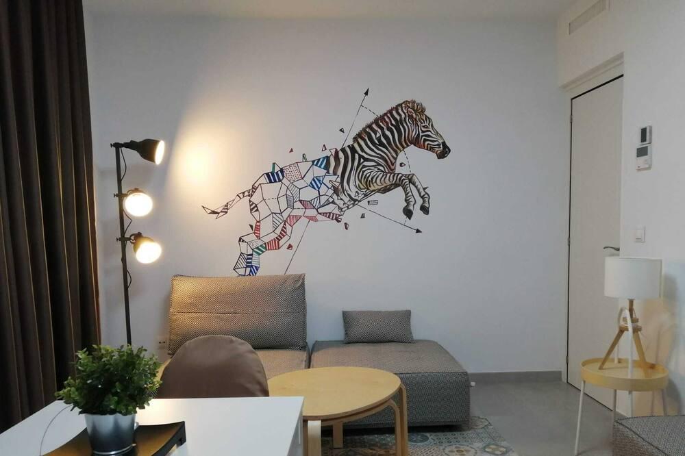 Apartamentai, bendras vonios kambarys (shared living room) - Svetainės zona