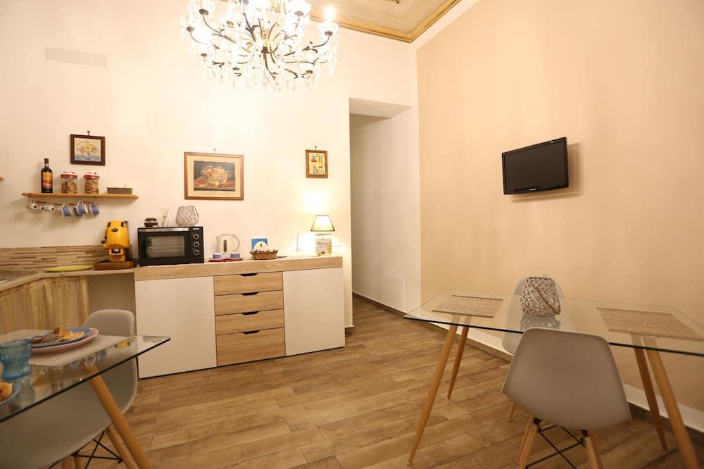 Camera Deluxe  con giardino Capo - Obývací prostor