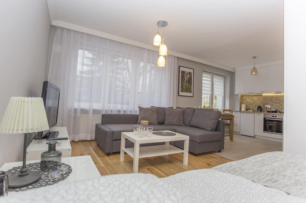 Appartement Confort, 1 grand lit et 1 canapé-lit, cuisine, vue cour intérieure - Coin séjour