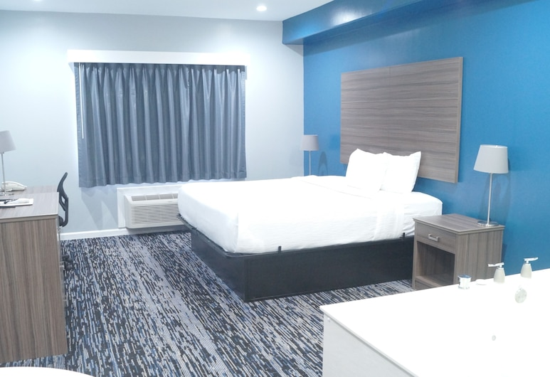 Magnolia Inn and Suites Olive Branch, Olive Branch, Deluxe suite, 1 kingsize bed, bubbelbad, Kamer