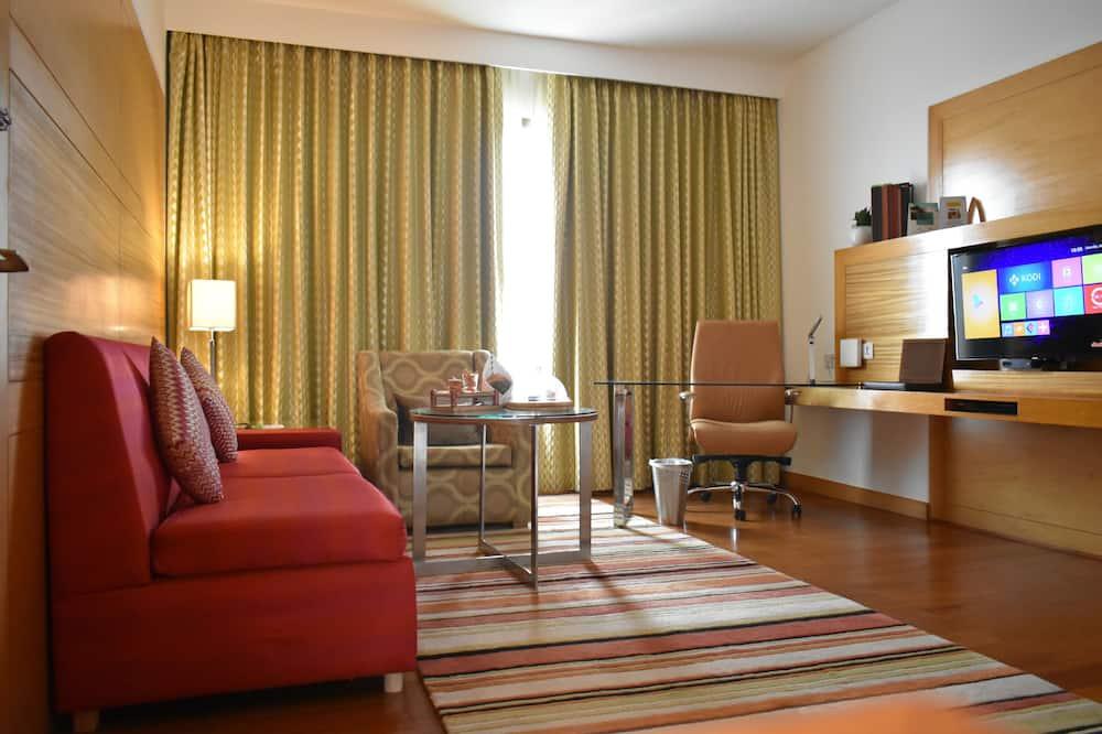 Полулюкс, 1 двуспальная кровать «Кинг-сайз», для некурящих - Зона гостиной