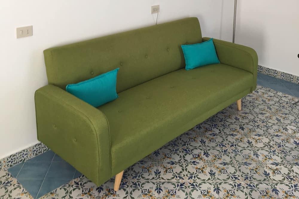 Superior Double Room, Patio - Living Area