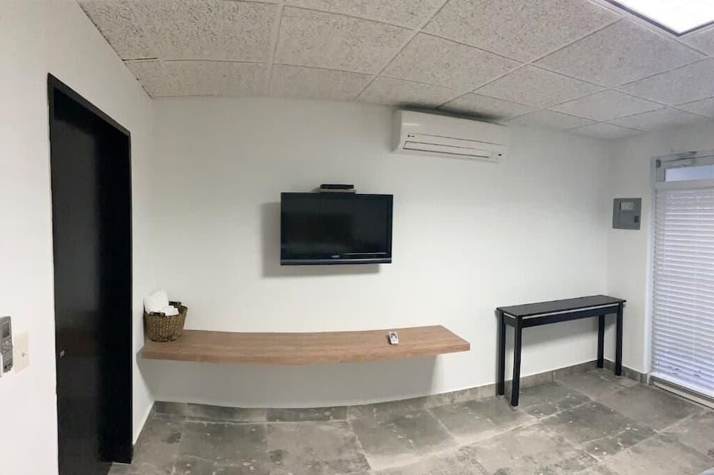 Estudio urbano, 1 cama Queen size, para no fumadores, planta baja - Sala de estar