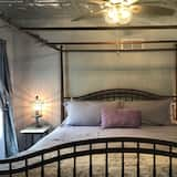 Izba typu Deluxe, 1 extra veľké dvojlôžko, chladnička a mikrovlnná rúra, výhľad na záhradu - Hosťovská izba