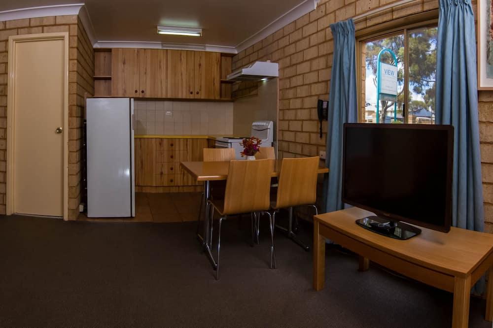 Appartement Exécutif, non-fumeurs, cuisine - Coin séjour
